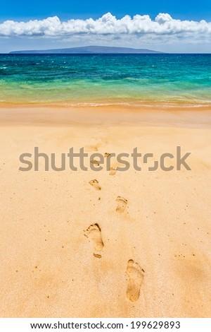 Footprints to paradise - stock photo