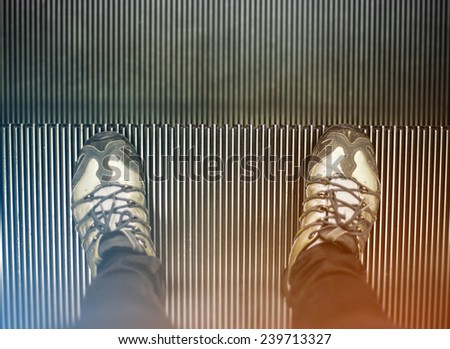 foots on escalator - stock photo