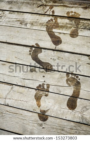 Footsteps on a pier closeup - stock photo