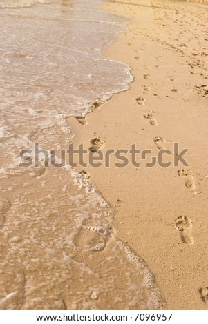 Footsteps on the shore - stock photo