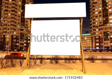 For advertisers to place ad copy samples on a bus shelter in evening city - stock photo