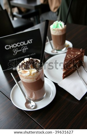 For dessert coffee with cream and chocolate cake - stock photo