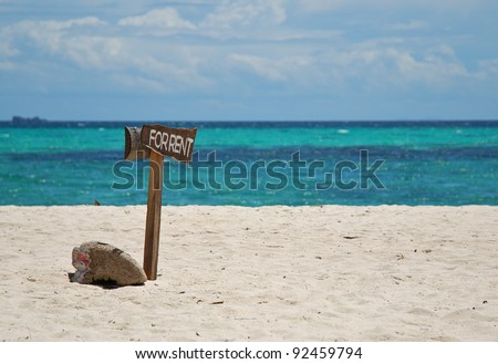 For rent sign on the white sand beach blue sea nice cloud - stock photo