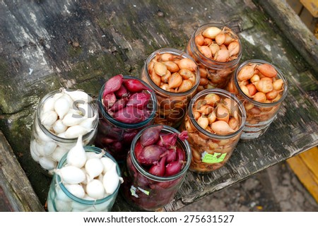 For sale at the village market, after the winter onion preserve, canning fruits and vegetables. Yellow onion and red onion - stock photo