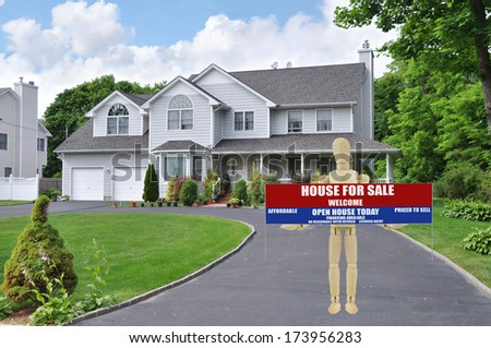 For Sale Real Estate Sign Open House Welcome held by Adult Wood Mannequin  Curb of Suburban McMansion Style Home Residential Neighborhood USA - stock photo