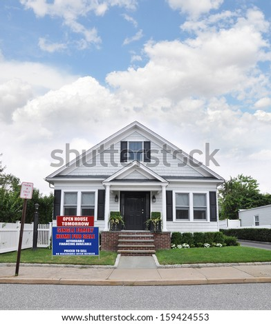 For Sale Sign Front Yard Lawn Suburban Bungalow Cottage Style Home Residential Neighborhood USA blue sky clouds - stock photo