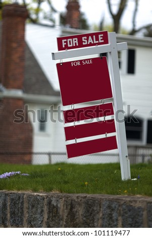 For sale sign in the front of a house for sale. - stock photo