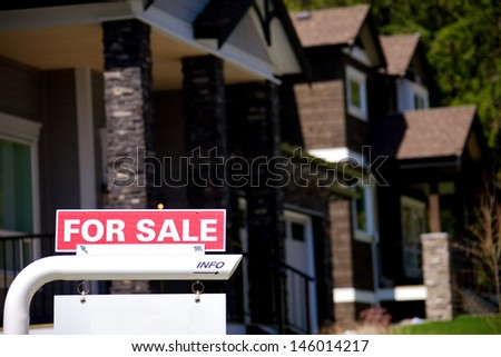 For sale signs in an upscale residential neighbourhood - stock photo