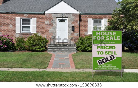 For Sale Sold Real Estate Sign Front yard Lawn Suburban Home Sunny USA - stock photo