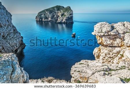 Foradada island seen from Capo Caccia, Italy - stock photo