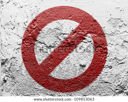 Forbidden sign painted on grunge wall - stock photo