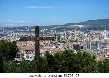 Foreground cross with the city of Marseille in background - stock photo