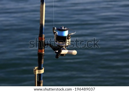 foreground reel a fishing rod - stock photo