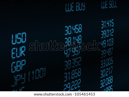 Foreign Currency Exchange Rate on Blue Display - stock photo