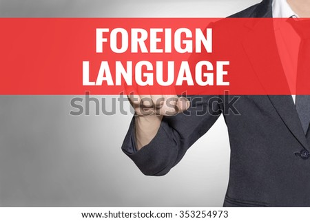 Foreign Language word Business man touching on red tab virtual screen for business concept - stock photo