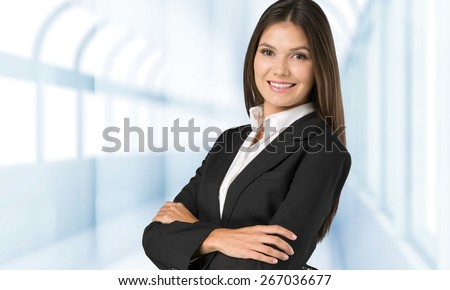 Foreign. Young attractive woman over the background with a different world languages (language school concept) - stock photo