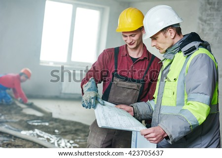 foreman builder and construction worker with blueprint in indoor apartment - stock photo