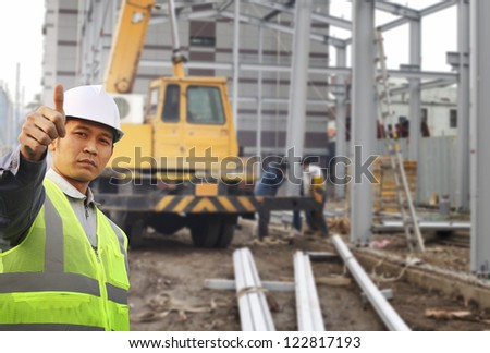 foreman construction site with construction background and worker - stock photo