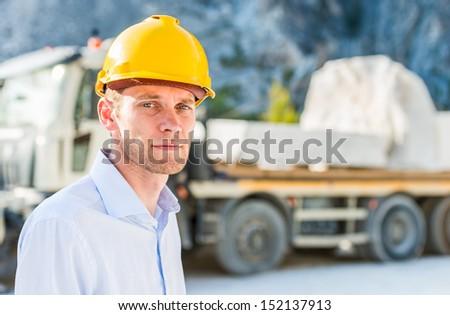 Foreman near a truck - stock photo