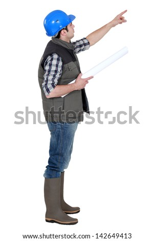 Foreman pointing into the distance - stock photo