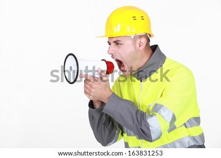 foreman shouting in loudspeaker - stock photo