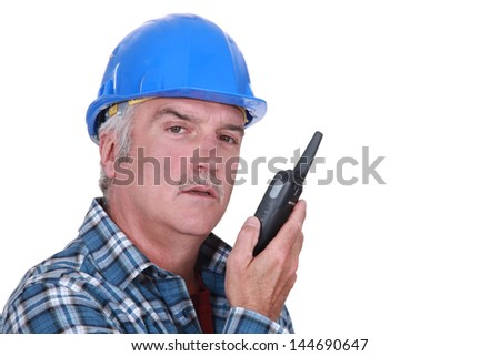 Foreman with radio receiver - stock photo