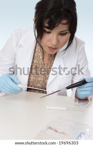 Forensic investigator takes a sample from a knife for further analysis - stock photo