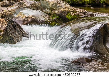 Forest creek with waterfalls. Water cascades over rocks in Great Smoky Mountains National Park. - stock photo