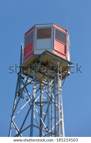 Forest fire watch tower tall architectural steel lookout structure overlooking forest of Rocky Mountains foothills, Alterta, Canada - stock photo