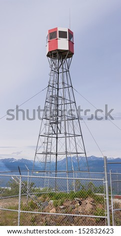 Forest fire watch tower tall architectural steel lookout structure overlooking mountain area of Tagish  Yukon Territory  Canada - stock photo
