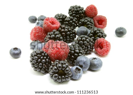 Forest fruit, raspberry, blackberry and blueberry on a white background. - stock photo