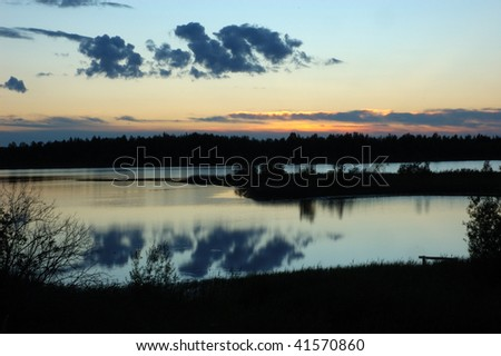 Forest lake at sunset, north Russia - stock photo