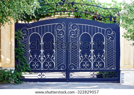 Forged, matal  gates. Front of the house. - stock photo