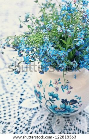 Forget-me-not flowers on a wooden table - stock photo
