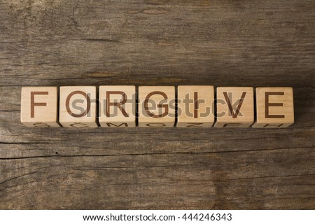 FORGIVE word on wooden cubes - stock photo