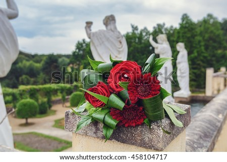 Forgotten in the park red bridal bouquet - stock photo