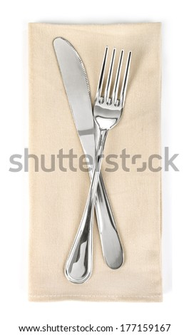 Fork and knife in   cloth isolated on white  - stock photo