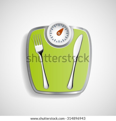 Fork and knife lying on the scales for weighing. - stock photo