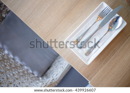 Fork and knife on a plate together. - stock photo