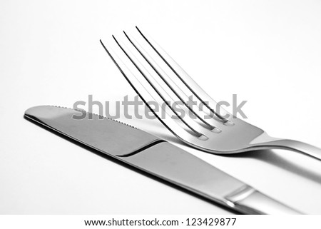Fork and knife on white - stock photo