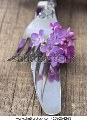 fork and knife with lilac - stock photo