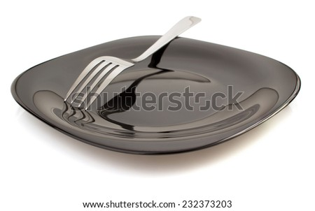 fork at plate isolated on white background - stock photo