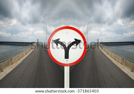 fork junction traffic sign with crossroads spliting in two way - stock photo