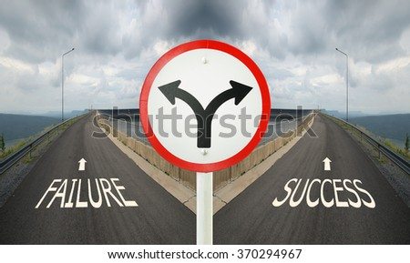 fork junction traffic sign with crossroads spliting in two ways, choose Failure or Success road the correct way - stock photo