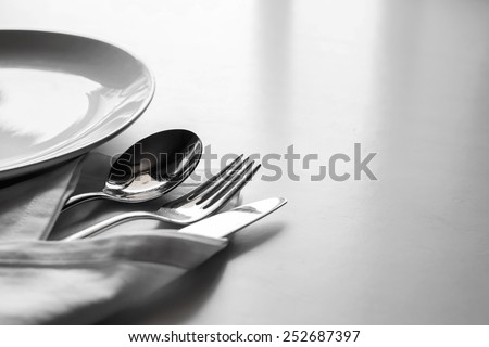 Fork ,knife and spoon with cotton serviette - stock photo