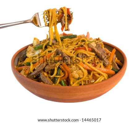 Fork lifting Noodle Beef Stir fry from serving bowl isolated over white background - stock photo