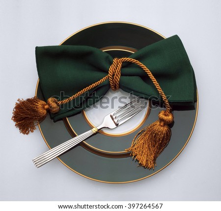 Fork, napkin on a plate - stock photo