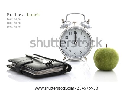 Fork on Filofax with Apple and Clock but no time for lunch, Business lunch Concept on a White Background with Copy Space - stock photo