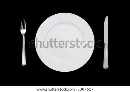 fork plate and knife isolated against black background - stock photo