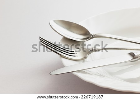 Fork, Spoon and Table Knife on the white background - stock photo